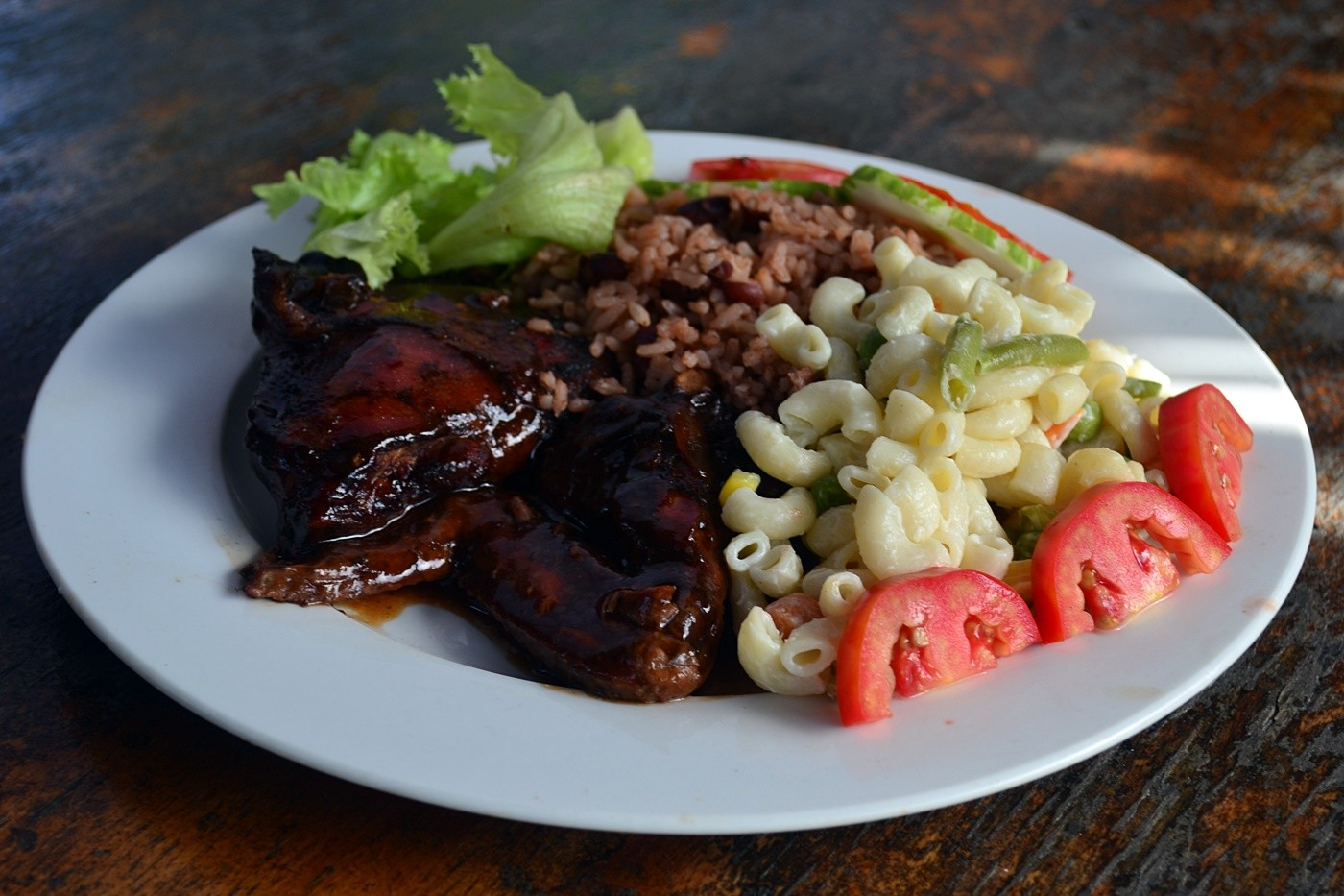 Pepper 39 s jerk center authentic jamaican restaurant for Authentic jamaican cuisine